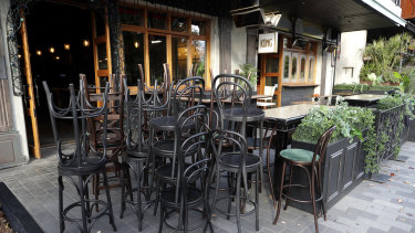 Bar stools are stacked outside a bar in Christchurch, New Zealand.