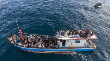 A boat carries ethnic Rohingya off North Aceh, Indonesia, on June 24.