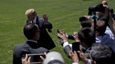 Donald Trump finishes speaking to the media before flying to Japan.