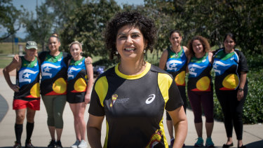 Front: ActewAGL general manager retail Ayesha Razzaq. Rear from left: Tuggeranong and Queanbeyan Deadly Runners Denis Reid, Jess Skipper, Jess Martin, Louise Lippitt, Tamsin Porter and Cara Smith.