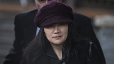 Huawei chief financial officer Meng Wanzhou leaves her home to attend court  in Vancouver last month.