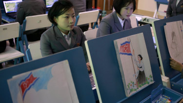 Students make drawings of North Korean flags during class at Pyongyang Teachers' University in Pyongyang last week.