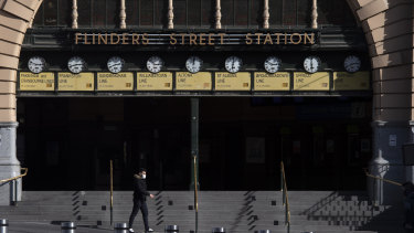 Flinders Street Station in Melbourne. The OECD says the Victorian lockdown has forced it to downgrade its forecasts for the Australian economy in 2021.