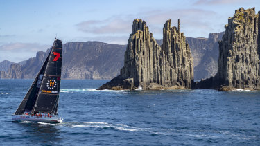 Victory under a cloud: Wild Oats XI closes in on Hobart on Friday morning.