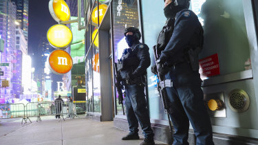 Members of the New York Police Department Emergency Services Unit patrol the Times Square area of New York on New Year's Eve.