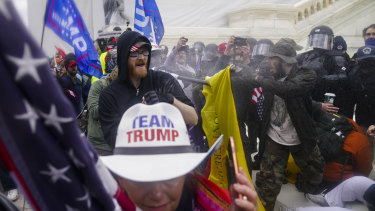 Trump supporters try to break through a police barrier at the Capitol on January 6.