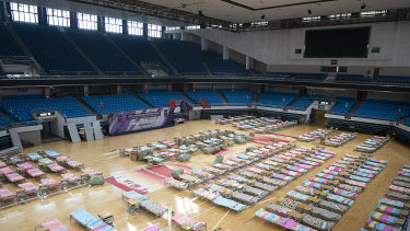 Beds are seen in a temporary hospital set up in the Hongshan Gymnasium in Wuhan in central China's Hubei Province.
