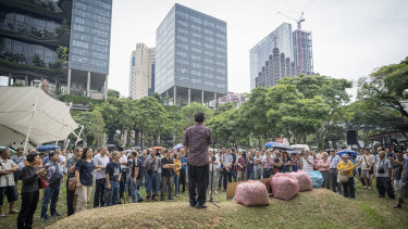 People gather to listen to a speaker during a protest on Hyflux Ltd. debt restructuring plan in Singapore.