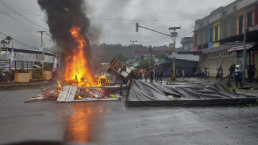 Fires burn during a violent protest in Manokwari, Papua province, Indonesia, Monday.