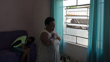 Malvina Firmina Nunes cries as she prays for her missing 35-year-old son Peterson Nunes Ribeiro at home in Brumadinho.