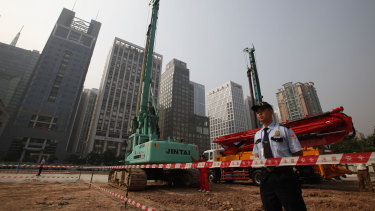 Security workers guard a construction site of the US Consulate compound in Guangzhou in southern China's Guangdong province.