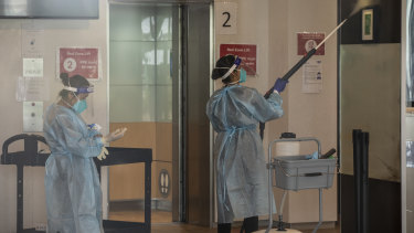 Cleaners wearing full PPE at the Holiday Inn this week.