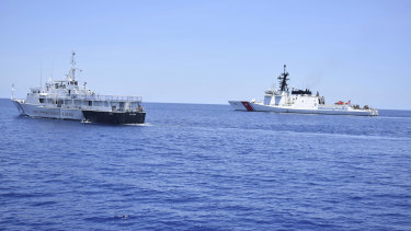 A US Coast Guard vessel, right, and a Philippine counterpart conduct joint exercises off the South China Sea west of the Philippines last year.