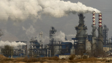 A coal processing plant in central China's Shanxi Province. Chinese power companies bid for credits to emit carbon dioxide and other climate-changing gases.