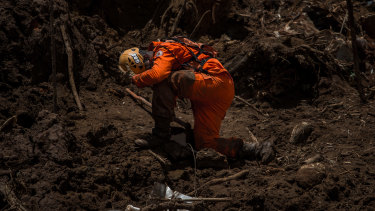 A rescue worker surveys damage after a Vale SA dam burst in Brumadinho, Minas Gerais state, Brazil, last month.