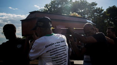 Relatives and friends attend the burial of a victim on Tuesday after a Vale dam burst in Brumadinho.