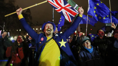 Anti-Brexit protesters react to the historic vote outside Parliament.