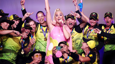 Katy Perry with the triumphant Australian team after they won the T20 World Cup final at the MCG.