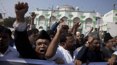 Indian Muslim men protest against the draft bill last year.