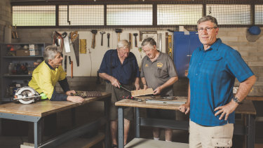 Workshop manager Allan Booth, committee member Graeme Ireland, vice president Bryan Blackburn, and (front) president Graham Lacey  at the new Men's Shed facilities at Weston Creek.