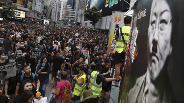 Protesters pack central Hong Kong, defying police.