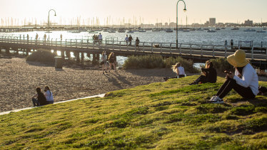Late afternoon sunshine at St Kilda beach on Saturday.