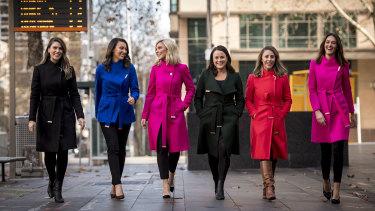 Cult coat ... (from left) journalists Sharnelle Vella, Estelle Griepink, Jacqui Felgate, Eliza Rugg, Laura Turner and Madeline Slattery are all fans of Ted Baker.