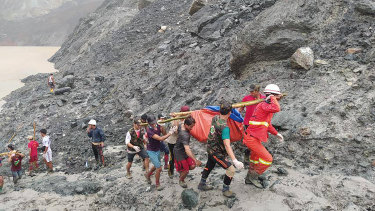 Rescue workers recover bodies after the landslide at a jade mine in Myanmar.