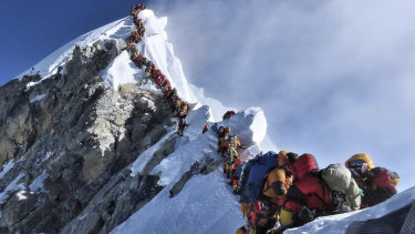 A photo of climbers lining up at the summit of Mount Everest has sparked a debate over deaths and traffic jams.