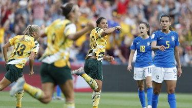 Matildas captain Sam Kerr (centre) celebrates during the match against Brazil.