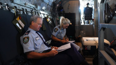 High flyer: Mick Willing travelling the state as part of his role heading up the bushfire recovery efforts.