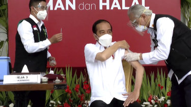 Indonesian President Joko Widodo, receives a shot against COVID-19 at the Merdeka Palace in Jakarta on Wednesday.