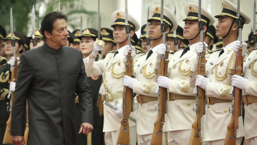 Pakistan's Prime Minister Imran Khan reviews the troops during a visit to Beijing last month.