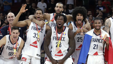 French players celebrate with their bronze medals after the play-off win over Australia.