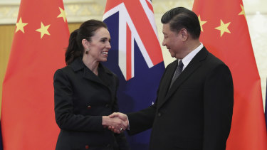 Chinese President Xi Jinping, right, and New Zealand Prime Minister Jacinda Ardern shake hands before their meeting at the Great Hall of the People in Beijing.