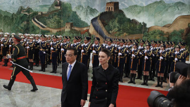 New Zealand Prime Minister Jacinda Ardern walks with Chinese Premier Li Keqiang after inspecting an honour guard during a welcome ceremony at the Great Hall of the People in Beijing on Monday, April 1.