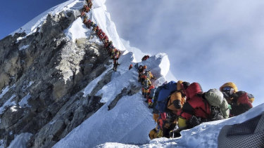 A photo of climbers lining up at the summit of Mount Everest sparked a debate over deaths and traffic jams.
