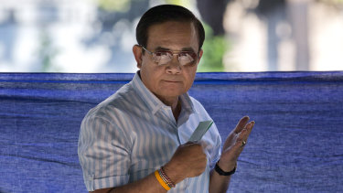 Thailand's Prime Minister Prayuth Chan-ocha casts a vote for himself.