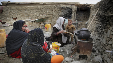 An Afghan family cooks food out in the open at a camp for internally displaced people in Kabul, Afghanistan, on Monday.
