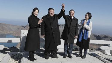 A life-long dream: South Korean President Moon Jae-in, second from right, and his wife Kim Jung-sook, right, stand with North Korean leader Kim Jong-un, and his wife Ri Sol Ju on the Mount Paektu.
