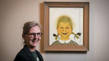 Charlotte Brack (daughter of artist John Brack) with his portrait of her.