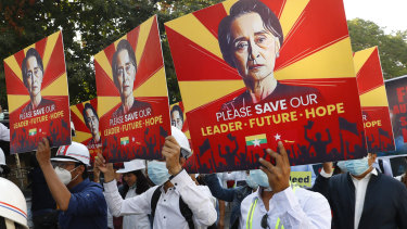 Engineers hold posters with an image of deposed Myanmar leader Aung San Suu Kyi as they hold an anti-coup protest march in Mandalay on Monday.