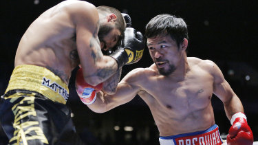 The eyes have it: Manny Pacquiao lines up Lucas Matthysse  during their WBA world welterweight title bout.