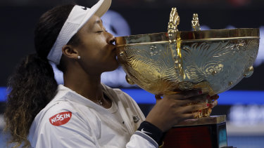 Golden moment: Naomi Osaka of Japan kisses her winner's trophy after her victory in the women's final at the China Open.