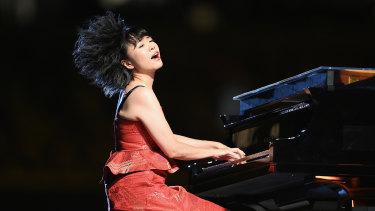 Japanese jazz composer Hiromi Uehara plays the piano.