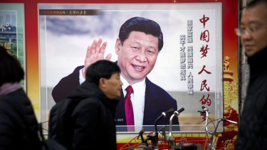 A billboard showing Chinese President Xi Jinping on a street in Beijing.