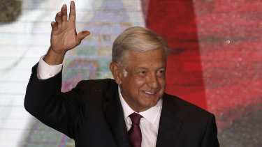 Presidential candidate Andres Manuel Lopez Obrador waves to supporters as he gives his first victory speech from his campaign headquarters in Mexico City on Sunday.