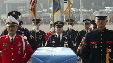 United Nations Command soldiers stand around the coffin during an honor guard departure ceremony in South Korea. One outcome of the summit between President Donald Trump and North Korean leader Kim Jong Un was the commitment to recover the remains of US military personnel missing-in-action from the Korean War.