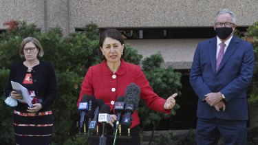 NSW Premier Gladys Berejiklian, with Chief Health Officer Kerry Chant and Health Minister Brad Hazzard, announce the easing of Sydney's lockdown restrictions for the Christmas period on Wednesday.