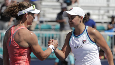 Compatriots: Ashleigh Barty and Samantha Stosur shake hands in Miami.